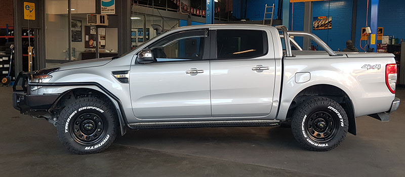 Supply and installation of aftermarket upgrades on a gray pick-up truck