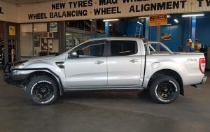 Customized grey pick up truck side view