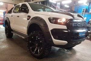 Customized white Ford pick up truck