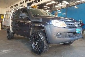 Customized black Volkswagen pick up truck