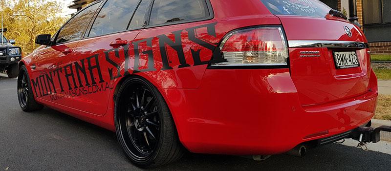 Customized red sedan car rear view